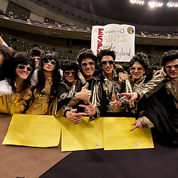 2009 November 30:  A group of New Orleans Saints fans pose in the stands during a 38-17 win by the New Orleans Saints over the New England Patriots at the Louisiana Superdome in New Orleans, Louisiana.