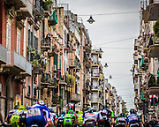 Local residents peering down from balconies as the riders make their way along Via Napoli. <br /> Stage 4, Bari, IT.<br /> Giro d'Italia, 2014
