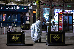 © Licensed to London News Pictures. 12/04/2021. Manchester, UK. A man carrying a duvet over his shoulders is seen in Piccadilly Gardens . People on a night out in Manchester City Centre as government restrictions to control the spread of Coronavirus are eased across the UK. Pubs, restaurants, hairdressers, gyms and non essential retailers are now permitted to serve customers within restrictions. Photo credit: Joel Goodman/LNP