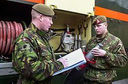 British Army brought in to provide Fire Cover in January & Febuary of 2003, during the fire fighers industrial dispute and strikes<br /> Members of 1st Batalion Dukes of Wellingtons Regement (West Riding) inventory one of the equipment lockers on a  Green Goddess in Barnsley and Sheffield <br /> <br /> Image Copyright Paul David Drabble<br /> 2003/01/27 13:16:33.6