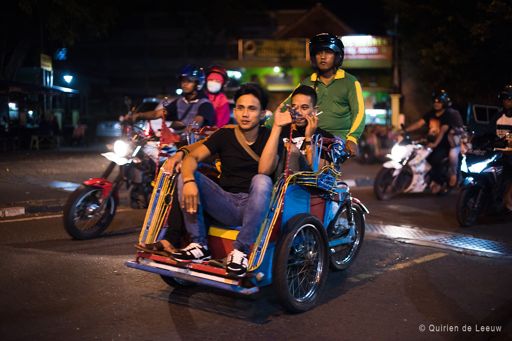 Young peope in a motorized becak taxi