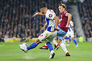 Brighton and Hove Albion midfielder Beram Kayal (7) crosses the ball with West Ham United midfielder Mark Noble (16) pressing during the Premier League match between Brighton and Hove Albion and West Ham United at the American Express Community Stadium, Brighton and Hove, England on 5 October 2018.