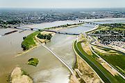 Nederland, Gelderland, Nijmegen, 09-06-2016; verlengde Waalbrug kruist de de nieuw aangelegde nevengeul van de rivier de Waal, ontstaan door de dijkverlegging bij Lent. Onderdeel van het project Ruimte voor de River (Ruimte voor de Waal). Op de landtong het stadseiland Veur-Lent, links de binnenstad van Nijmegen, midden onder de ingang van de nevengeul met drempel.<br /> The finished dike relocation of Lent (project Ruimte voor de Rivier: Room for the River) with the resulting flood trench. Entrance to the secondary channel with the threshold. In the background the city of Nijmegen.<br /> luchtfoto (toeslag op standard tarieven);<br /> aerial photo (additional fee required);<br /> copyright foto/photo Siebe Swart
