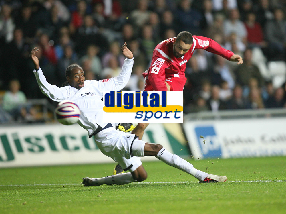 Photo: James Davies.<br />Swansea City v Swindon Town. Coca Cola League 1. 02/10/2007. <br />Swindon`s Christian Roberts shoots just wide as Dennis Lawrence misses tackle.