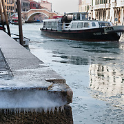 VENICE, ITALY - FEBRUARY 05:  A waterbus (vaporetto) sails along a partially frozen Canal of Cannaregio  on February 5, 2012 in Venice, Italy. Italy as most of Europe is under a spell of very cold weather, it is more than 20 years aince the Venice Lagoon last froze.  (Photo by Marco Secchi/Getty Images)