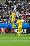 SAINT-DENIS, FRANCE, 10.06.2016 - FRANCE-ROMANIA -Olivier Giroud of France dispute the ball with Dragos Grigore (the ball) of Romania, in a match valid for the 1st round of Group A of Euro 2016 in the Stade de France, in Saint-Denis, on Friday (10).