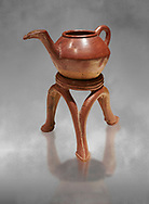 Terra cotta Hittite beaker shaped side spouted teapot and three legged stand - 1700 BC to 1500BC - Kültepe Kanesh - Museum of Anatolian Civilisations, Ankara, Turkey .<br /> <br /> If you prefer to buy from our ALAMY STOCK LIBRARY page at https://www.alamy.com/portfolio/paul-williams-funkystock/hittite-art-antiquities.html  - Type Kultepe into the LOWER SEARCH WITHIN GALLERY box. Refine search by adding background colour, place, museum etc<br /> <br /> Visit our HITTITE PHOTO COLLECTIONS for more photos to download or buy as wall art prints https://funkystock.photoshelter.com/gallery-collection/The-Hittites-Art-Artefacts-Antiquities-Historic-Sites-Pictures-Images-of/C0000NUBSMhSc3Oo