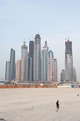beach at Jumeirah Beach resort district with high rise buildings to rear in Dubai, United Arab Emirates,UAE