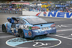 July 22, 2018 - Loudon, New Hampshire, United States of America - Kevin Harvick (4) takes the checkered flag and wins the Foxwoods Resort Casino 301 at New Hampshire Motor Speedway in Loudon, New Hampshire. (Credit Image: © Justin R. Noe Asp Inc/ASP via ZUMA Wire)