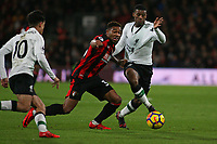 Football - 2017 / 2018 Premier League - AFC Bournemouth vs. Liverpool<br /> <br /> Bournemouth's Jordon Ibe grabs Georginio Wijnaldum of Liverpool shirt in an attempt to win the ball at Dean Court (Vitality Stadium) Bournemouth <br /> <br /> COLORSPORT/SHAUN BOGGUST
