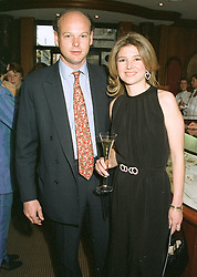The HON.CHARLES & MRS HAMBRO, he is the son of banker Lord Hambro, at a fashion show in London on April 30th 1997.LYA 6
