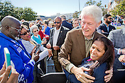 Bill Clinton mingles with supporters at the Bill Clinton 'Stronger Together' Bus Tour event in Rocky Mount, North Carolina on Tuesday, October 25, 2016.