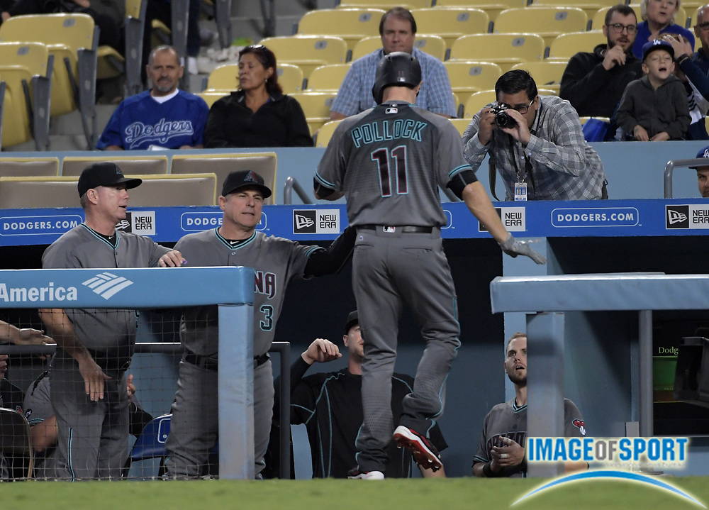 Sep 6, 2016; Los Angeles, CA, USA; Arizona Diamondbacks center fielder A.J. Pollock (11) is congratulated by Arizona Diamondbacks manager Chip Hale (3) after hitting a solo home run in the first inning against the Los Angeles Dodgers during a MLB game at Dodger Stadium.