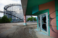 Broken rollercoaster at Six Flags New Orleans amusement park. Six Flags New Orleans amusement park in Eastern New Orleans, Louisiana, closed since Hurricane Katrina  in 2005 remains in a sate of ruin. The remains of Six Flags amusement park are on low lying land owned by the city of New Orleans and have not be redeveloped since Katrina.