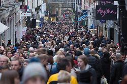© Licensed to London News Pictures. 3/12/2016. Lincoln, UK. Thousands of people descended upon Lincoln over the weekend to start their Christmas shopping and visit the annual Christmas market. With over 200 stalls surrounding the Cathedral and Castle in the uphill area a one way system to control visitors had to be put in place due to the huge crowds thronging the City Centre. Picture shows the busy High Street running through the centre of Lincoln. Photo credit: Dave Warren/LNP