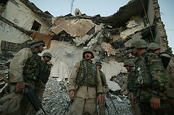 U.S. soldiers from the 203rd Engineers within the 1st AD prepare to comb the site of the explosion  at the Canal Hotel for bodies in Baghdad, Iraq on Aug. 21, 2003. The previous day a cement truck packed with explosives detonated outside the offices of the UN headquarters in Baghdad, Iraq, killing 20 people and devastating the facility in an unprecedented suicide attack against the world body. At least 100 people were wounded.