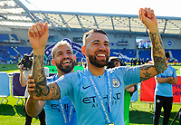 BRIGHTON, ENGLAND - MAY 12:   Sergio Aguero (10) of Manchester City celebrates winning the Premier League with Nicolas Otamendi (30) of Manchester City during the Premier League match between Brighton & Hove Albion and Manchester City at American Express Community Stadium on May 12, 2019 in Brighton, United Kingdom. (MB Media)