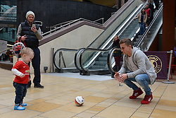 Bristol City's Joe Bryan plays football with a young fan - Photo mandatory by-line: Dougie Allward/JMP - Mobile: 07966 386802 - 11/03/2015 - SPORT - Football - Bristol - Cabot Circus Shopping Centre - Johnstone's Paint Trophy