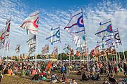 Flags in the West Holts field. The 2015 Glastonbury Festival, Worthy Farm, Glastonbury.