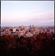 The view at sunset of downtown Montreal from the Mount Royal park, which includes the highest spot in the city
