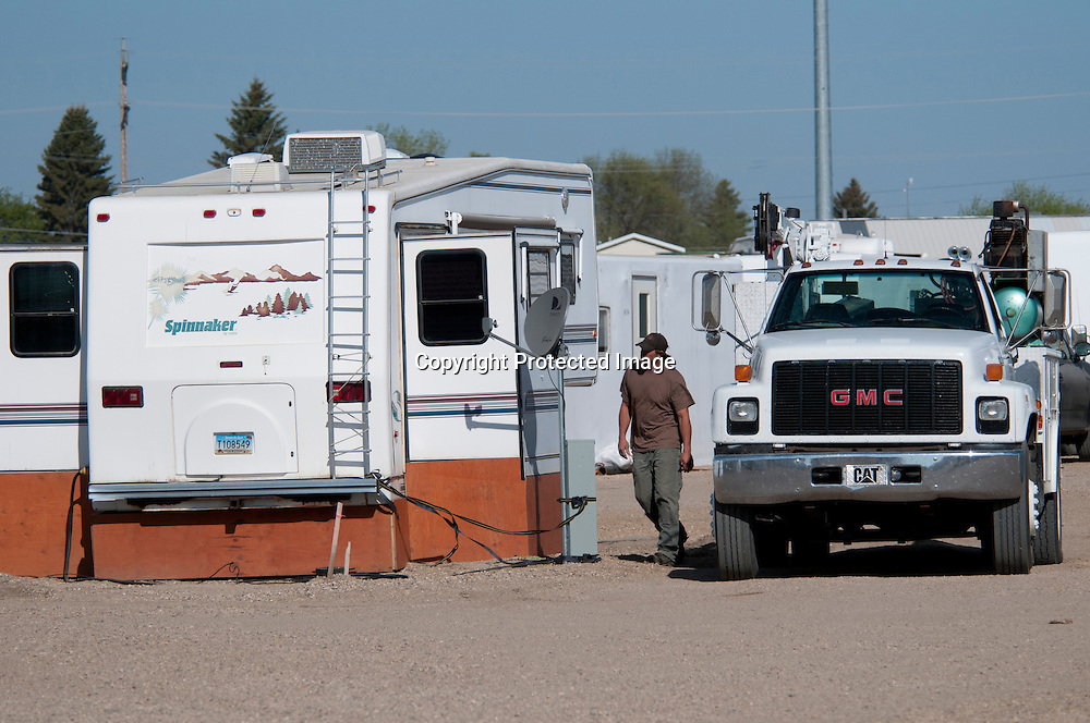A Bakken oil field worker by his personal trailer at a man-camp in the small town of Tioga north-east of Williston, North Dakota.  The oil boom has crerated a housing shortage in the region.