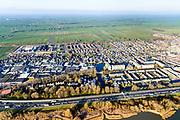 Nederland, Zuid-Holland, Hardinxveld-Giessendam, 07-02-2018; zicht op Neder-Hardinxveld en de Alblasserwaard. Onder in beeld autosnelweg A15.<br /> Urban area next to polder, province South Holland.<br /> <br /> luchtfoto (toeslag op standard tarieven);<br /> aerial photo (additional fee required);<br /> copyright foto/photo Siebe Swart