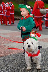Over 1600 Santa's and their little helpers take part in Scotland's fundraising Santa's run, walk and stroll around Edinburgh's West Prices Street Gardens, raising money to grant the Wishes of Children for When You Wish Upon A Star. Sunday 11th December 2016. (c) Brian Anderson | Edinburgh Elite media