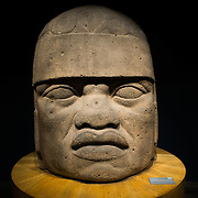 MEXICO CITY, MEXICO--A large carved stone head, known as Cabeza Colosal, dating to 1200-600 BC on display at the National Museum of Anthropology in Mexico City. The National Museum of Anthropology showcases  significant archaeological and anthropological artifacts from the Mexico's pre-Columbian heritage, including its Aztec and indiginous cultures.