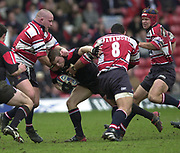 Watford, GREAT BRITAIN, 3rd April 2004, Vicarage Road, ENGLAND. [Mandatory Credit: Photo  Peter Spurrier/Intersport Images],<br /> 03/04/2004  - 2003/04 Zurich Premiership - Saracens v Gloucester<br /> Robbie Kydd is caught by Phil Vikery [left] Junior Paramore, Jake Boer moving in from the right.