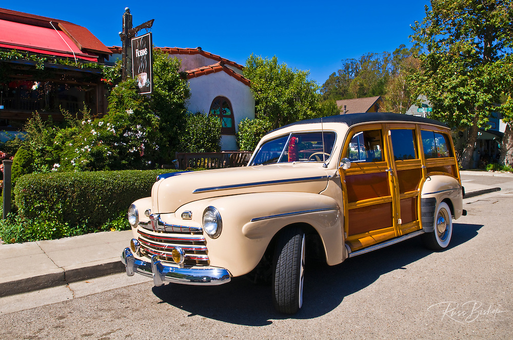 Classic woodie station wagon in front of Robin's Restaurant, Cambria, California
