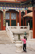 Young girl at The Summer Palace, Beijing. China has a one child family planning policy to limit population.