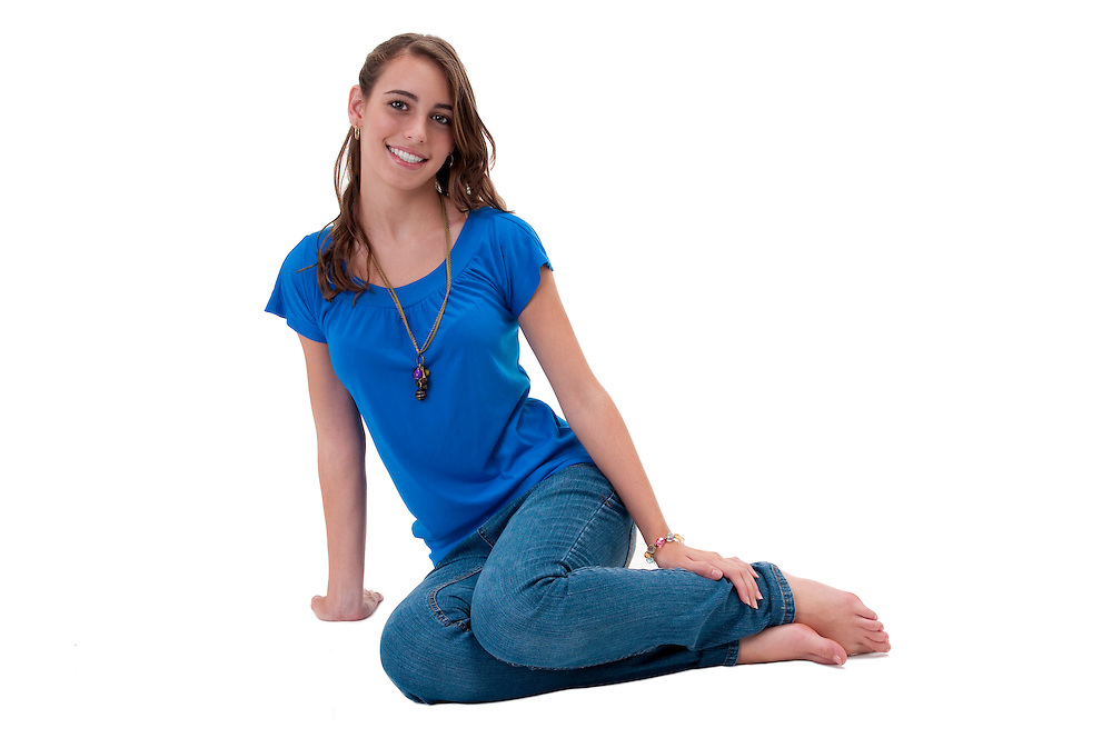 Young and happy caucasian woman, seated in the floor.