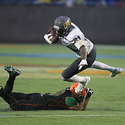 Bethune Cookman receiver Michael Jones (21) gets tripped up by Florida A&M Rattlers defensive back Jules Dornevil (13) during the Florida Classic NCAA football game between the FAMU Rattlers and the Bethune Cookman Wildcats at the Florida Citrus bowl on Saturday, November 22, 2014 in Orlando, Florida. (AP Photo/Alex Menendez)