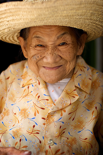This happy woman was delighted to pose for a few portraits in Yangshuo, China.