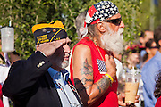 30 MAY 2011 - PHOENIX, AZ: Veterans salute the Color Guard at Memorial Day services in the National Memorial Cemetery in Phoenix, AZ, Monday. Memorial Day was celebrated with services across the United States Monday.    Photo by Jack Kurtz