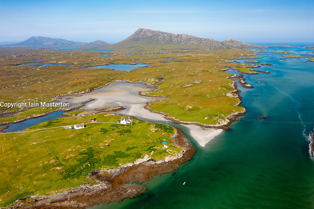 Aerial view from drone of coastal landscape on  Benbecula with Eaval mountain in the distance in the Outer Hebrides, Scotland, UK