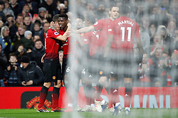 Manchester United's Paul Pogba (second left) celebrates scoring his side's second goal of the game during the Premier League match at Old Trafford, Manchester.