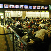 LAS VEGAS, NV - JANUARY 15:  Sports enthusiasts, especially football fans, gather in the sports book inside the Green Valley Ranch Resort and Spa in Las Vegas on January 15, 2005 to watch everything from horse races to the NFL playoffs. Sports Illustrated rated the sports book, complete with oversize, leather chairs, as one of the top places in the country to watch sports. (Photo by Todd Bigelow/Aurora)