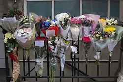 © licensed to London News Pictures. London, UK 13/12/2012. Flowers left outside King Edward VII hospital's staff building for Jacintha Saldanha, the nurse who apparently took her own life after being duped by two Australian DJ hoax callers. Photo credit: Tolga Akmen/LNP