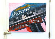 """This """"shareware"""" acrylic painting of Bellevile's Skyview Drive-In is on the back of a door. Photo taken on January 8, 2019 for """"At Home"""" feature on Sandy Stolberg, who uses dollar store finds as part of the decorations in her Belleville, IL condo.<br /> Photo by Tim Vizer"""