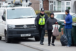 © Licensed to London News Pictures. 05/01/2019. Coventry, West Midlands UK. Burnaby Road, north Coventry where police have shot dead a man. Police escort residents from their houses from the cordoned off road. Photo credit: Dave Warren/LNP