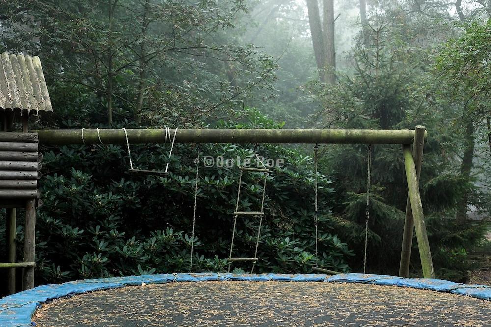 abandoned children swing, climbing rack and trampoline