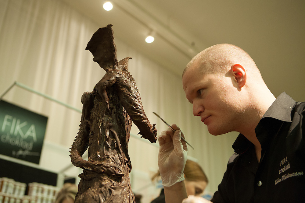 Håkan Mårtensson of FIKA Chokolad of New York, carving a winged dragon in chocolate. Mårtensson won a gold medal in the 2008 Culinary Olympics.