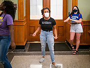 19 JUNE 2020 - DES MOINES, IOWA: Supporters of Black Lives Matter during a Juneteenth rally in front of the Governor's office in the Iowa State Capitol. About 100 supporters of Des Moines Black Lives Matter finished their week long series of protests at the Iowa State Capitol with a Juneteenth rally and demonstration. They are demanding that Gov. Kim Reynolds use an executive order to restore voting rights to felons who have completed their sentences. The protesters did not meet with the Governor Friday. The protest was peaceful.       PHOTO BY JACK KURTZ