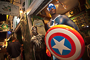 Costumed revelers dressed as Captain America during Fantasy Fest halloween parade in Key West, Florida.