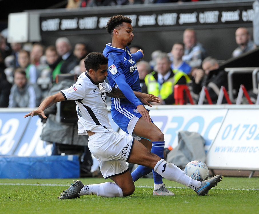 Cardiff City's Josh Murphy is tackled by Swansea City's Kyle Naughton <br /> <br /> Photographer Ian Cook/CameraSport<br /> <br /> The EFL Sky Bet Championship - Swansea City v Cardiff City - Sunday 27th October 2019 - Liberty Stadium - Swansea<br /> <br /> World Copyright © 2019 CameraSport. All rights reserved. 43 Linden Ave. Countesthorpe. Leicester. England. LE8 5PG - Tel: +44 (0) 116 277 4147 - admin@camerasport.com - www.camerasport.com