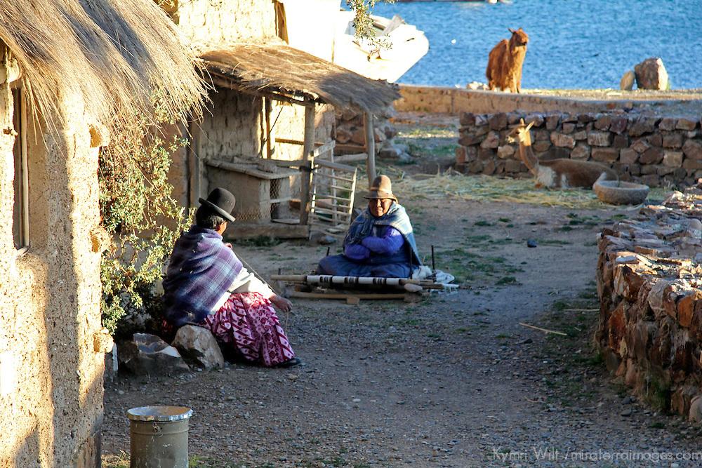 South America, Bolivia, Huatajata. Women of Huatajata on Lake Titicaca.