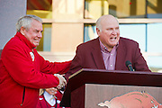 Nov 23, 2012; Fayetteville, AR, USA; Former Arkansas Razorbacks  Jim Lindsey and Dick Hatfield speak during a dedication ceremony before the start of a game against the Louisiana State Tigers at Donald W. Reynolds Stadium.  A seven and a half foot statue weighing more than 700 pounds was dedicated to Frank Broyles who served the University of Arkansas for more than 50 years in his career. Mandatory Credit: Beth Hall-US PRESSWIRE