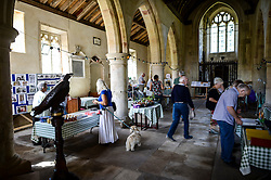People visit inside St. Giles Church in Imber village on Salisbury Plain, Wiltshire, where residents were evicted in 1943 to provide an exercise area for US troops preparing to invade Europe. Roads through the MoD controlled village are now open and will close again on Monday August 22.