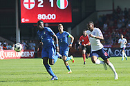 Paolo Gozzi Iweru of Italy (6) chases Rayhaan Tulloch of England (16) during the UEFA European Under 17 Championship 2018 match between England and Italy at the Banks's Stadium, Walsall, England on 7 May 2018. Picture by Mick Haynes.